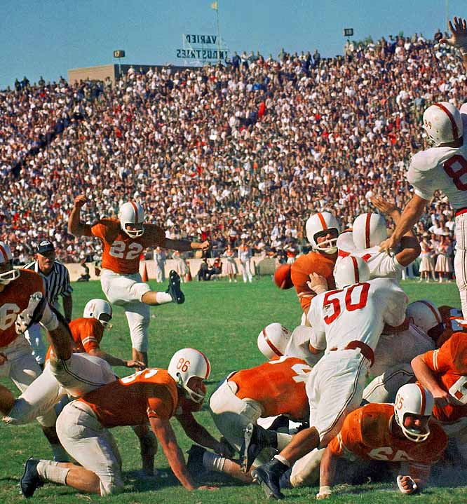 "In 1959, SI's Kenneth Rudeen wrote,  ""Rising high above the pack of fallen linemen, Jerry Tillery, Oklahoma's right end, reaches to heaven in a valiant but futile effort to block Quarterback Bobby Lackey's extra-point attempt after the first Texas touchdown ... Orange-shirted Longhorns went on to defeat Oklahoma 19-12 before 75, 581 fans in the Cotton Bowl in Dallas."""