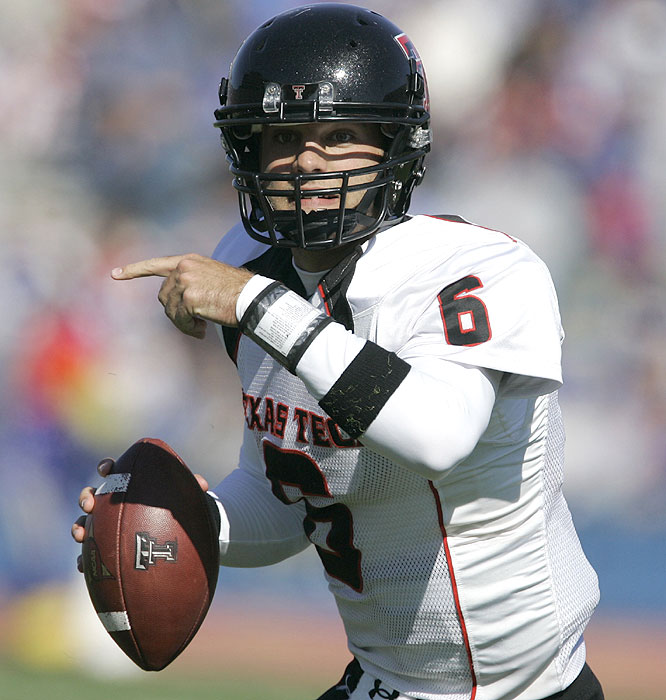 Graham Harrell passed for 386 yards and five touchdowns for the Red Raiders, who scored on eight of their nine possessions.