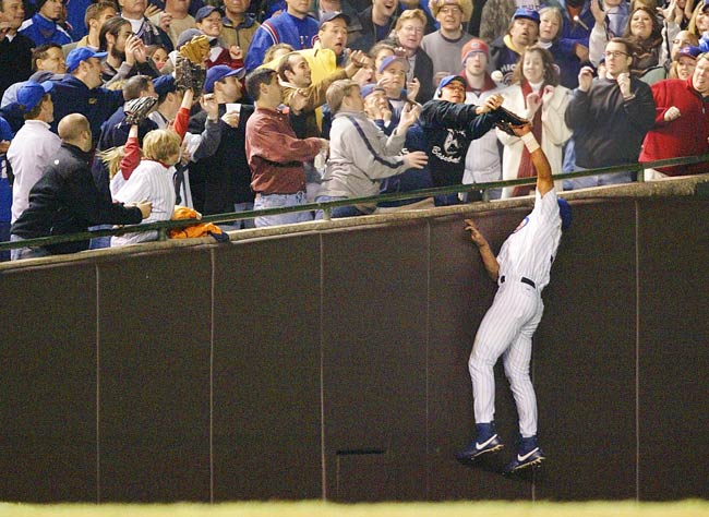 Holding a 3-0 lead and needing only five more outs to go the World Series for the first time since 1945, the Cubs give up eight runs, on five hits, three walks and an error to the Marlins. The team appears to come apart after a fan named Steve Bartman, sitting along the left-field line at Wrigley Field, tries to catch a foul ball that was about to be caught by Cubs' outfielder Moises Alou for the second out of the inning.