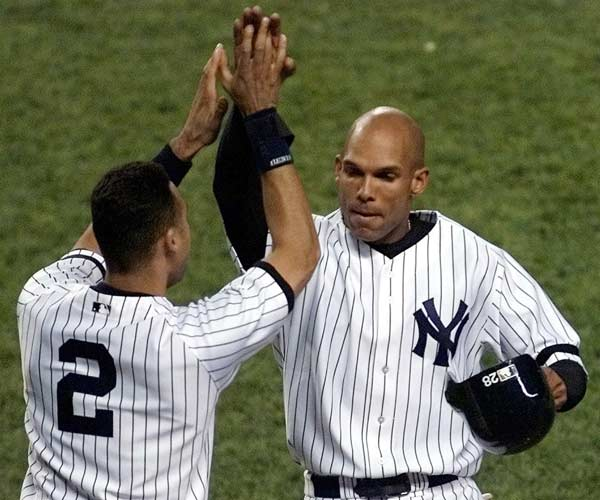 David Justice's three-run homer propels the Yankees to their record 37th American League pennant in a come-from-behind victory over the Mariners, 9-7. The victory sets up a Subway Series in New York for the first time in 44 years.