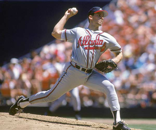 Led by John Smoltz, the Atlanta Braves beat the Pittsburgh Pirates in seven games to win the NL pennant.