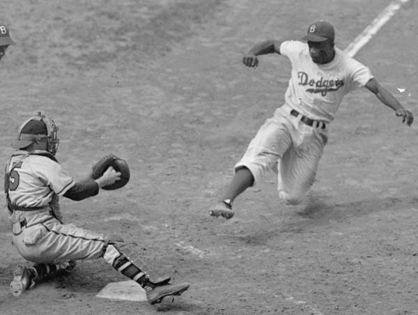 Jackie Robinson dies of heart disease at his home in Stamford, Conn. The 53-year old Hall of Famer broke the color line playing for the Brooklyn Dodgers in 1947.