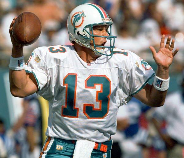 Miami QB Dan Marino breaks Fran Tarkenton's NFL career completions record (3,686).