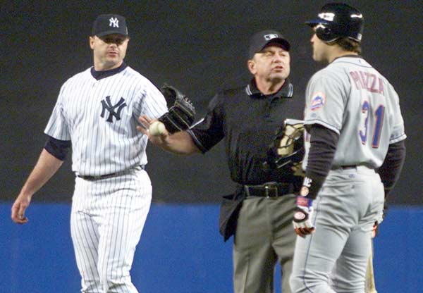 In Game 2 of the 2000 World Series, Roger Clemens throws the barrel of a shattered bat at Mike Piazza as the Met catcher runs to first. The eagerly awaited at bat, due to the Rocket's beaning of the Mets' superstar in July, results in the two players confronting one another and the emptying of both benches.