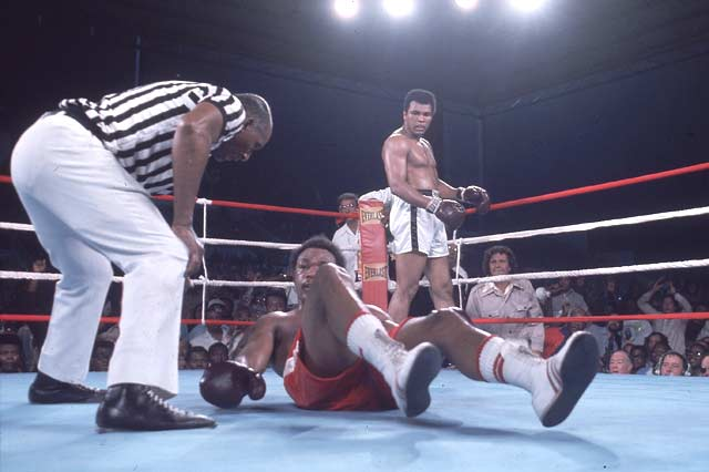 In Kinshasa, Zaire, Muhammad Ali regained his heavyweight-boxing title by knocking out George Foreman in the eighth round.