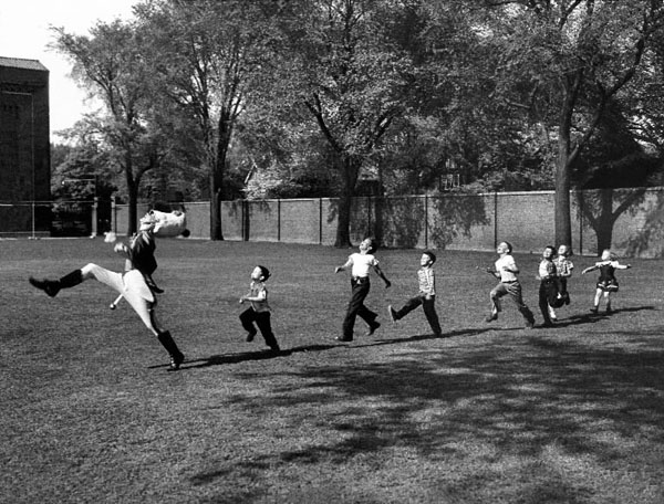 """On the Ann Arbor campus, nothing much was happening--and then, suddenly, something was. """"It was early in the morning,"""" Alfred Eisenstaedt later recalled about the moment he spotted the school's drum major, rehearsing. Next: """"I saw a little boy running after him, and all the faculty children on the playing field ran after the boy. And I ran after them. This is a completely spontaneous, unstaged picture."""" It is also, he confided, """"another picture I hope to be remembered by."""" Eisie, who died in 1995 at age 96, got his wish. In fact, when President Bill Clinton was offered any Eisenstaedt print as thanks for a sitting in 1993, he chose this one."""