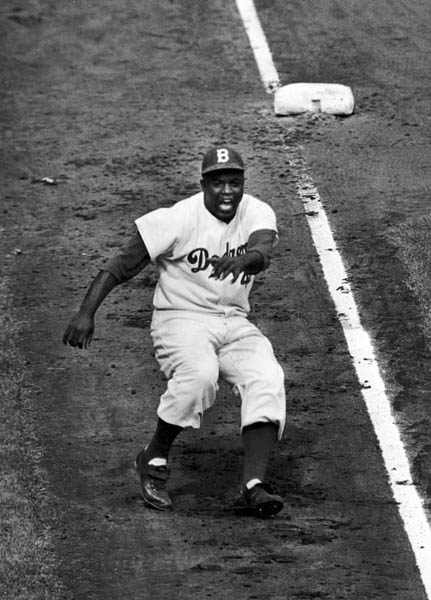 Classic sports photos are different: In many instances, they don't fill out until later, the perfect image telling the multilayered story of the whole. Ralph Morse had already made searing images for LIFE during World War II when, in 1955, he stuck with Jackie Robinson during the Brooklyn Dodgers' World Series showdown against their awe-inducing crosstown rivals, the Yankees. Robinson was, of course, the first black player in the major leagues, and he was terrific. Off the field, he played demure. On the field, he shouted the future. Morse caught Robinson rounding third base, and the Dodgers went on to beat the Yanks. A perfect picture suddenly meant more.