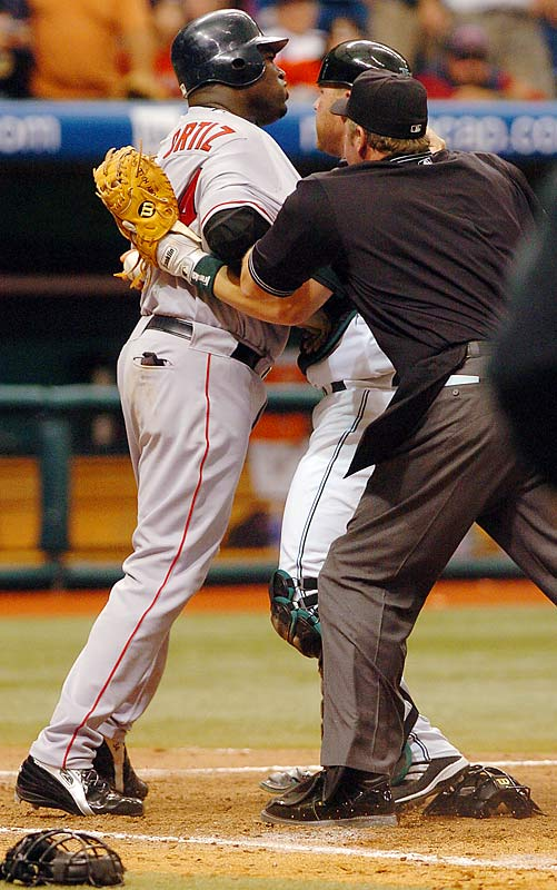 "Manny Ramirez homered one pitch after nearly being plunked in a game that saw beanings, near beanings and six ejections. In the seventh inning, Rays pitcher Lance Carter nearly hit Ramirez before throwing a pitch over the head of David Ortiz, the next batter, bringing players out of both dugouts. In the bottom half of the inning, the benches cleared again when Arroyo hit Chris Singleton. After the game, Ortiz talked about the game and the pitch that almost hit his head: ""That's dangerous. I think they need to stop the hitting thing."""