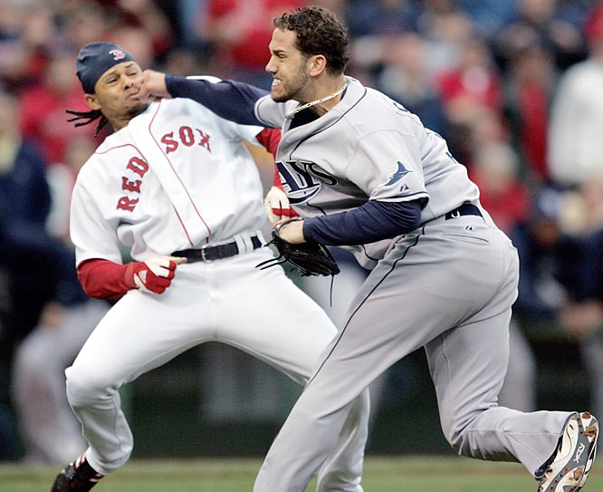 The Rays and Red Sox are getting ready to rumble in the ALCS this Friday. It's their first postseason matchup, but the teams have a long history of fighting that dates to the start of the decade. Here's a recap.<br><br>One day after his hard slide took out Rays second baseman Akinori Iwamura, Red Sox outfielder Coco Crisp found himself on the receiving end of a James Shields fastball. Crisp charged the mound, and, as the benches cleared, dodged a roundhouse punch from Shields. When the fight was over, Shields, Crisp and the Rays' Jonny Gomes were ejected. Eight players were suspended.