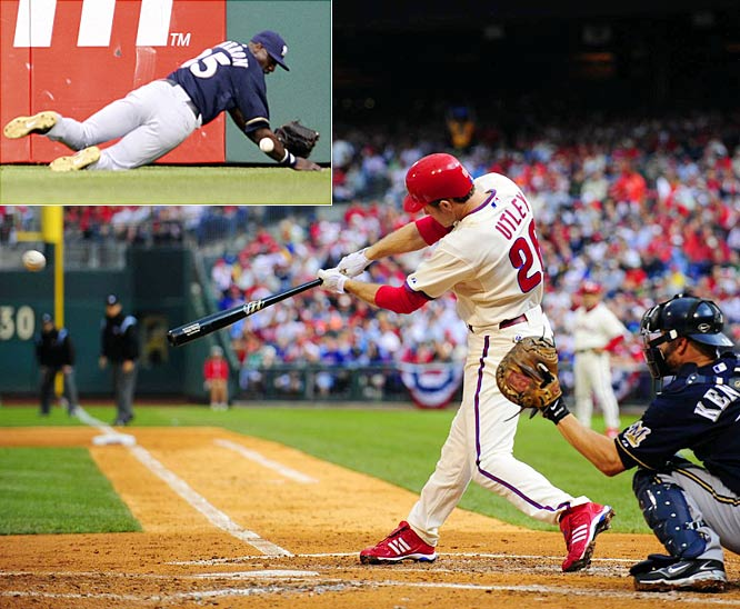Chase Utley's two-run double slipped out of Mike Cameron's glove as the Phillies took a 3-0 lead in the third inning and Cole Hamels dominated the Brewers in a 3-1 victory, helping the Phils to their first postseason victory since Game 5 of the 1993 World Series.