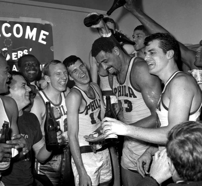 Wilt Chamberlain helped set what was then an NBA record with 68 regular season wins as the 76ers broke Boston's string of eight consecutive championships.