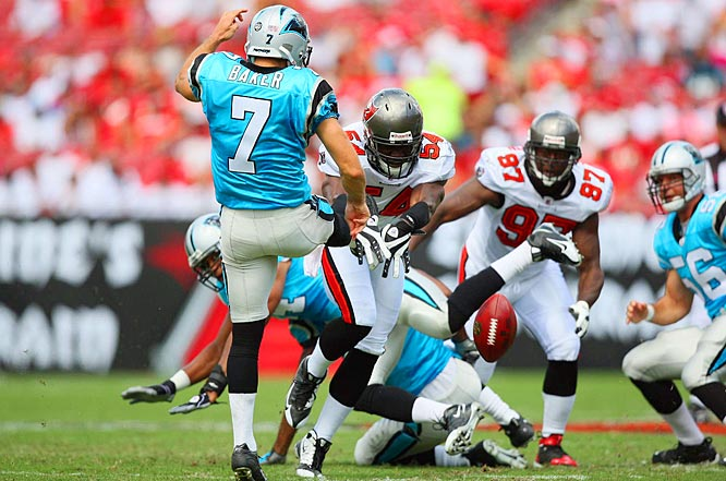 Bucs linebacker Geno Hayes (54) blocks the punt attempt by Jason Baker before returning it 22 yards for a touchdown in the first quarter of Tampa Bay's 27-3 win over Carolina.