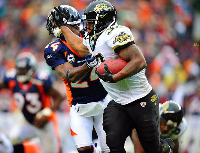 Maurice Jones-Drew pushes away Broncos cornerback Champ Bailey during a 24-17 win for the Jaguars.  Jones-Drew ran for 125 yards and two TDs on 22 carries after Fred Taylor got hurt.