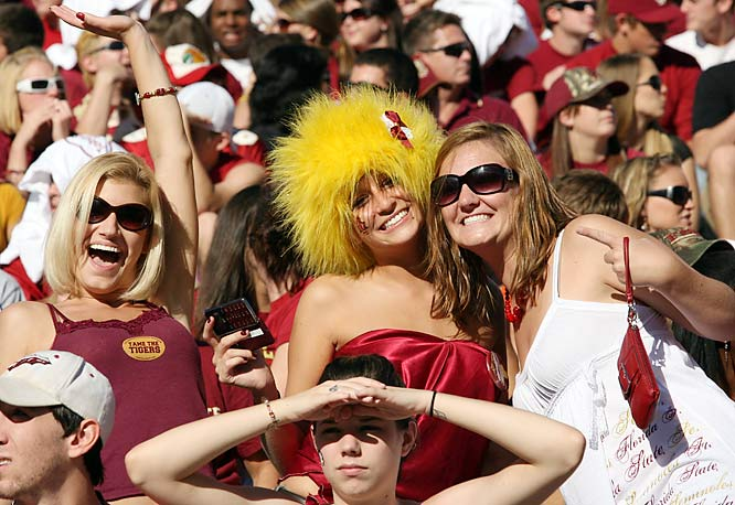 It takes a bold Seminoles fan to wear this kind of wig when her friends look so normal.