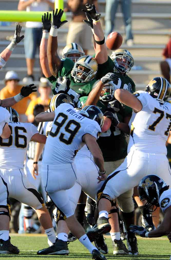 Jeff Wolfert kicked a 34-yard field goal with 2:31 remaining to help Missouri stave off an upset. Heisman contender Chase Daniel threw for 318 yards and three touchdowns for Mizzou.