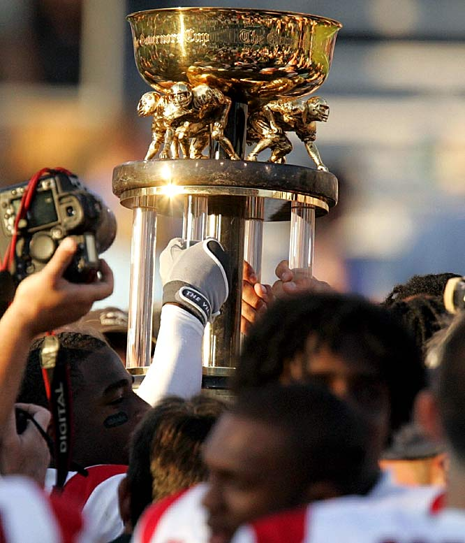 Kentucky Wildcats vs. Louisville Cardinals    Trophy introduced in 1994.