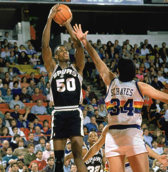 David Robinson makes his debut for the San Antonio Spurs against the Los Angeles Lakers. Robinson's NBA debut was delayed two years because of his military commitment.