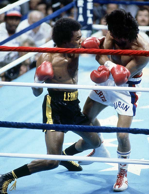 "In a rematch of their epic ""Brawl in Montreal"" earlier in the year, Sugar Ray Leonard defeats Roberto Duran and regains the WBC welterweight championship. Duran famously refuses to come out for the eighth round, giving Leonard a decision by TKO."