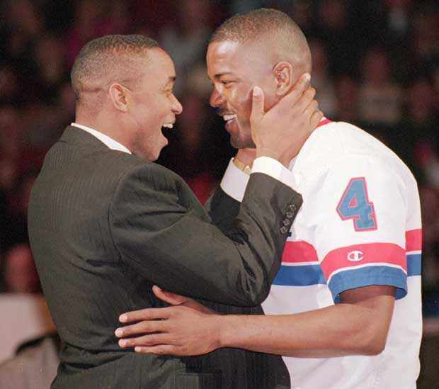 The NBA names Joe Dumars (pictured here with Isiah Thomas) of the Detroit Pistons as the recipient of the first-ever NBA Sportsmanship Award.