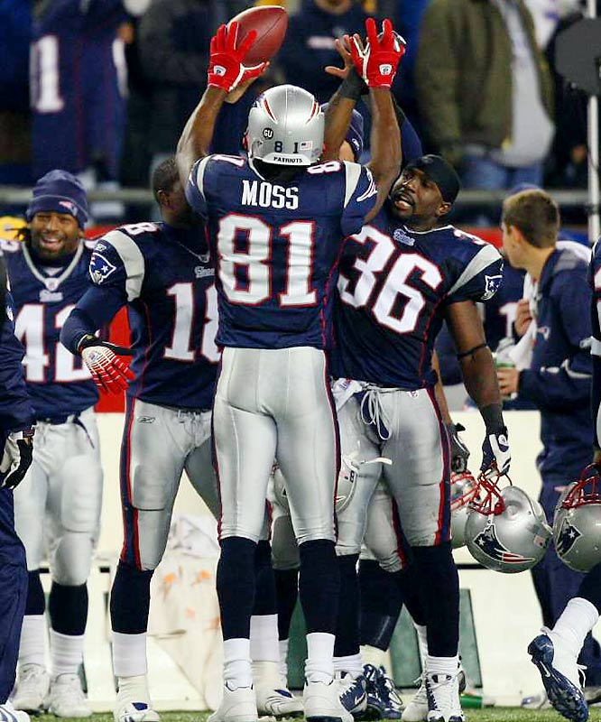 Randy Moss celebrates on the Patriots' sideline after catching the game-tying touchdown pass with one second left in regulation.