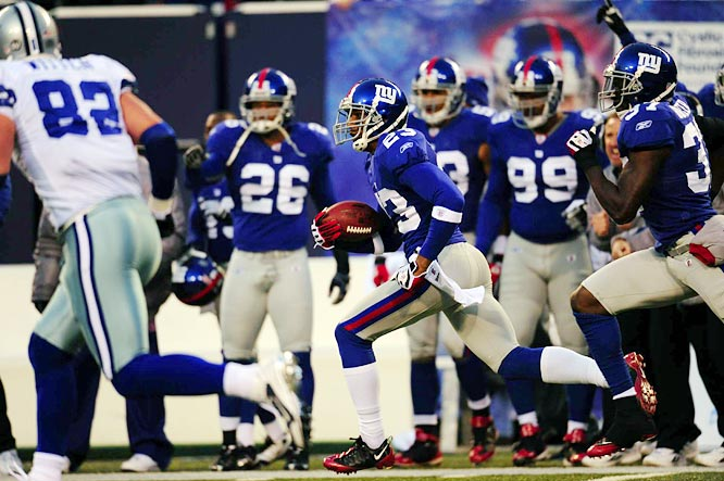 Corey Webster had the first two-interception game of his career and helped send Cowboys quarterback Brad Johnson to the bench while giving the Giants great field position during their 35-14 victory.