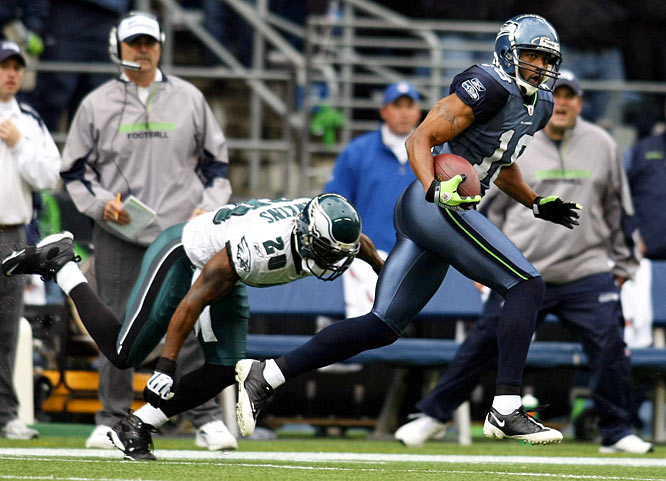 Koren Robinson caught a team-record 90-yard touchdown pass from Seneca Wallace on Seattle's opening play against the Eagles.  Robinson caught four passes for 105 yards -- his first 100-yard receiving game in three years -- in the Seahawks 26-7 loss.