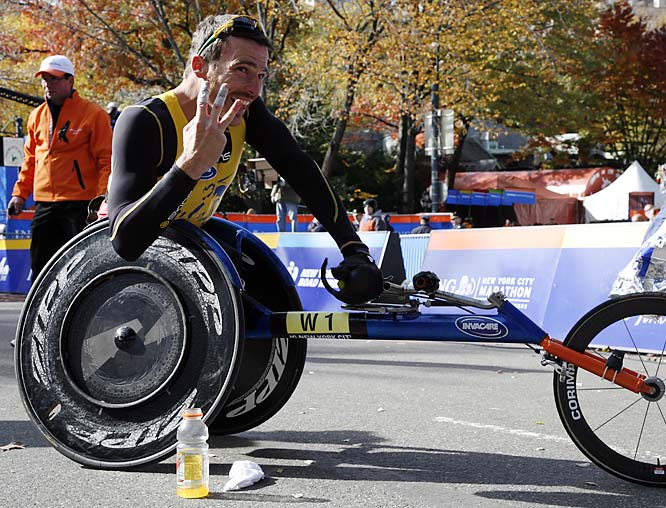 "Kurt Fearnley of Australia celebrates his third consecutive win in New York, finishing the course in 1:44:51. ""I love this city and I love this race, that's three in a row now, I'd like to make it a few more,"" he said afterward."
