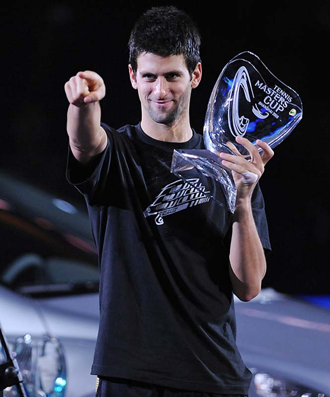 Novak Djokovic with trophy after overwhelming Russia's Nikolay Davydenko 6-1, 7-5 in the Masters Cup final on Sunday.