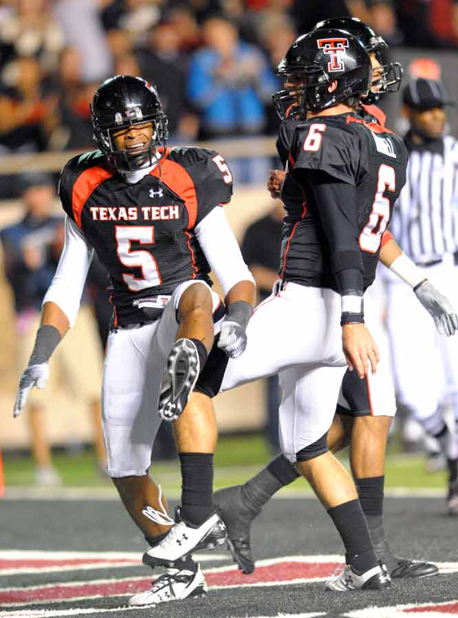 Texas Tech's big guns put up Nintendo-esque numbers. Graham Harrell (6) completed 40-of-50 passes for 454 yards and six touchdowns, three to star wideout Michael Crabtree (far left). Next up after the bye week: No. 6 Oklahoma.
