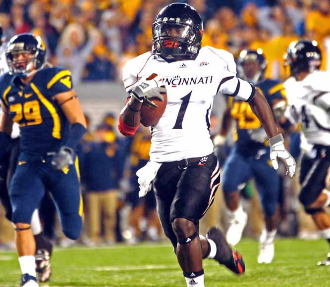 Mardy Gilyard (1) returned the opening kick off for a touchdown, but West Virginia stormed back late to force OT.  Tony Pike tossed a 2-yard touchdown to Kazeem Alli to finish the upset in Morgantown.