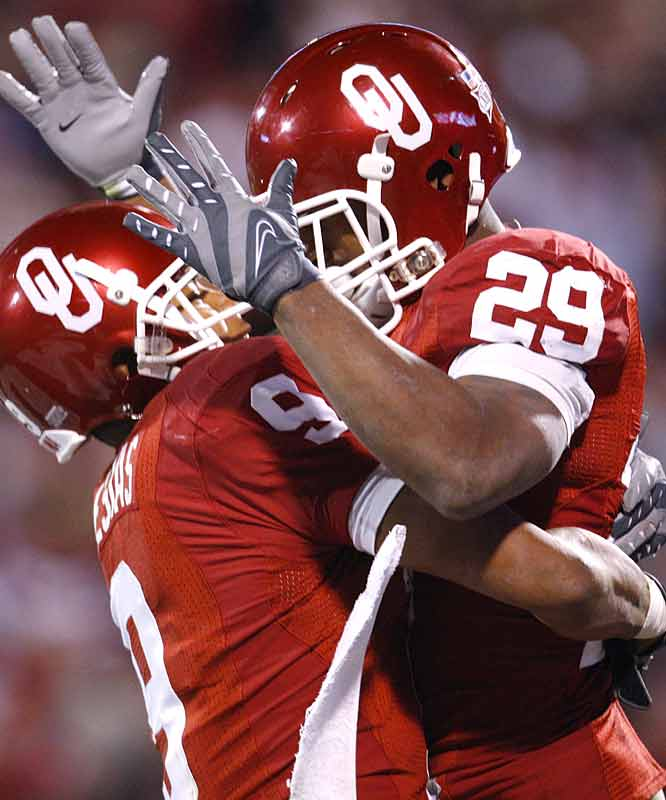 Juaquin Iglesias (left) and Chris Brown combined for 126 yards and four TDs in the Sooners' landslide win, which forced a three-way tie in the Big 12 South (along with Texas and Texas Tech). Oklahoma travels to Oklahoma State next week.