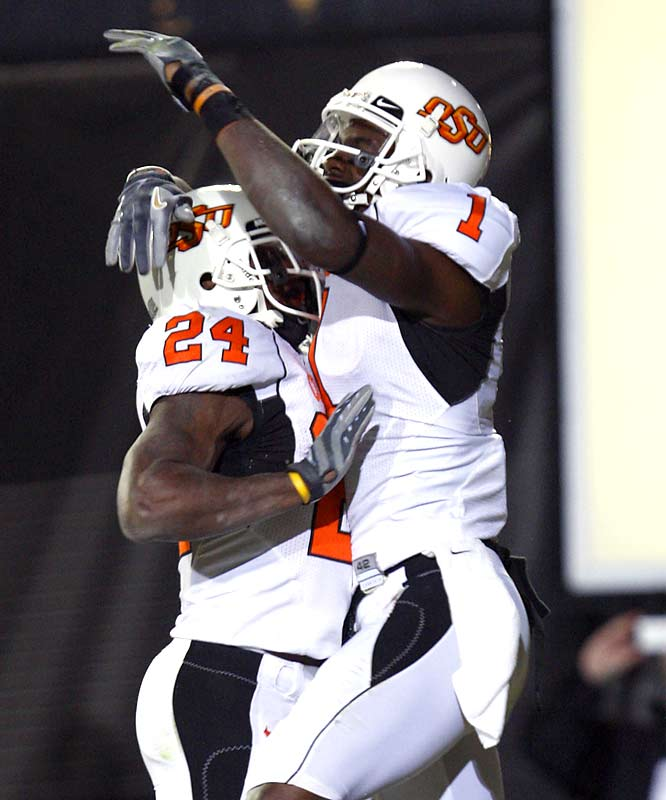 Oklahoma State wide receiver Dez Bryant (right) has taken some heat for only producing in home games (15 TDs when playing in Stillwater). On Saturday in Boulder, the explosive pass-catcher (4 catches, 82 yards) scored his first away-touchdown of the season.