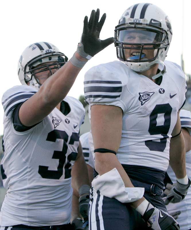 Pass-catchers Dennis Pitta (left) and Austin Collie caught a combined 16 balls for 243 yards and two touchdowns in the Cougars' road win in Colorado Springs. BYU has its showdown with No. 8 Utah next week.