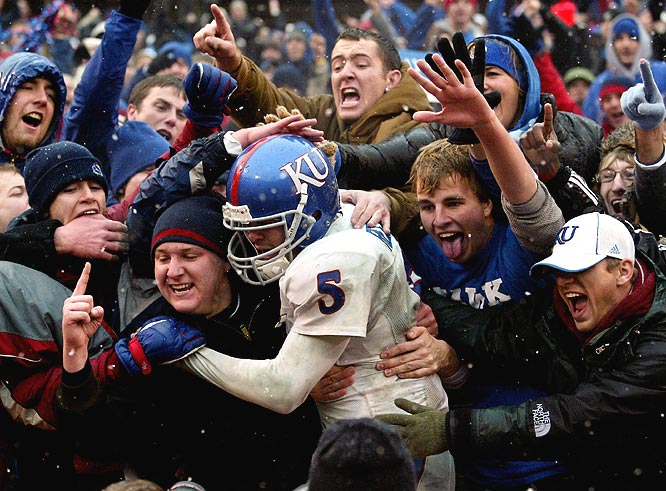 Kansas quarterback Todd Reesing is greeted by fans after giving the Jayhawks a big win with a TD pass with 27 seconds left.