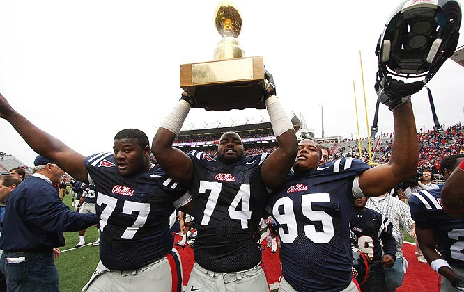 Ole Miss' Michael Oher (center) hoists the Golden Egg with teammates after cruising past the rival Bulldogs.