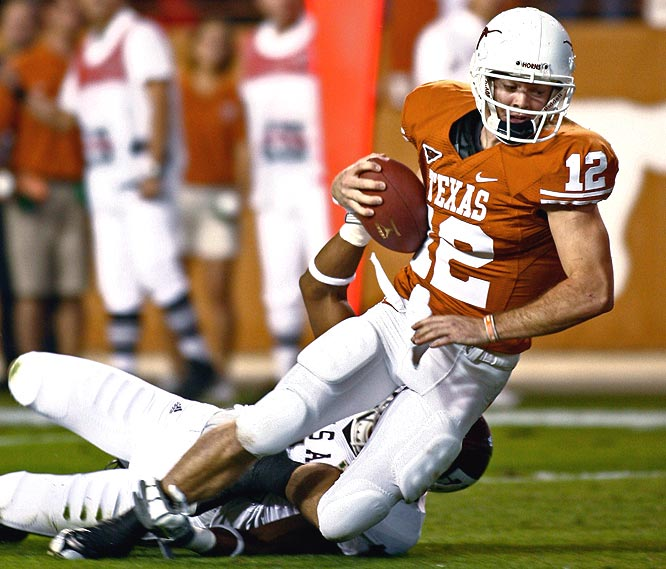 Texas quarterback Colt McCoy completed 23 of 28 for 311 yards and 2 TDs in a rout of the Aggies to improve his Heisman chances.