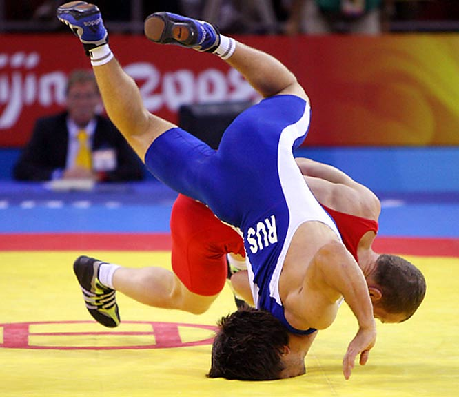 Mavlet Batirov of Russia gets his face planted while taking on Vasyl Fedoryshyn of Ukraine during the Beijing Games.