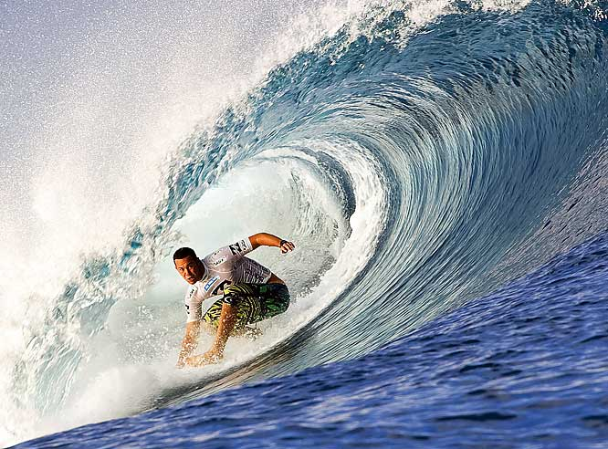 Jordy Smith of South Africa rides through the tube of the wave at the Billabong Pro surfing tournament in Teahupoo, Tahiti.