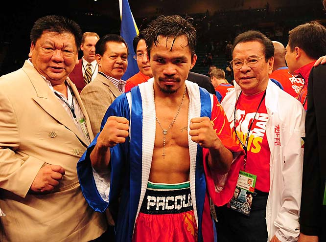 "After the fight, Philippines president Gloria Macapagal Arroyo called Pacquiao to congratulate him on the win. With his country facing many financial woes, Pacquiao was deemed a ""saving grace"" who helped to unify and boost the morale of Filipinos.<br><br>Send comments to siwriters@simail.com."