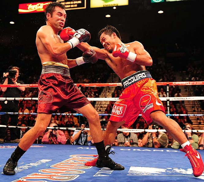 Manny Pacquiao (red gloves) was already a star in the Philippines. But on Dec. 6, he solidified his place among the biggest stars in the ring. The WBC lightweight champion destroyed Oscar De La Hoya in a fight many expected the Golden Boy to win. The eighth-round TKO victory bumped Pacquiao's record to a jaw-dropping 48-3-2 with 36 knockouts, while De La Hoya dropped to 39-6.