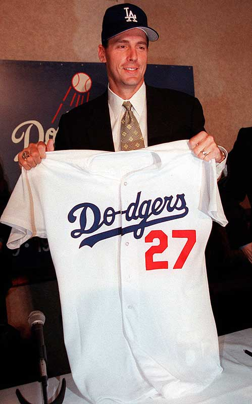 In a deal that upsets many other owners, pitcher Kevin Brown (18-7, 2.38) becomes baseball's first $100 million dollar man as the right-hander signs a seven-year deal with the Dodgers for an average yearly salary of $15 million.