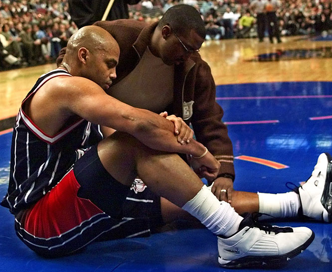 Houston forward Charles Barkley's career comes to an end when he tears his left quadriceps in a game against Philadelphia.