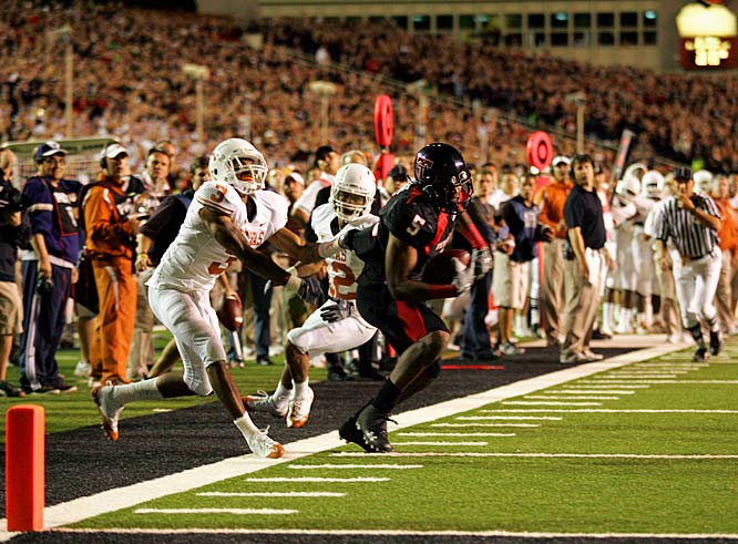 The Red Raiders upended No. 1 Texas in a back-and-forth shootout with BCS implications. With the final seconds ticking off and Texas Tech trailing by a point, Graham Harrell saw Michael Crabtree in double coverage and let it fly. The All-American wide receiver hauled in the pass, shook off a defender and ducked into the end zone with one second left, sealing a 39-33 upset win for No. 6 Texas Tech.