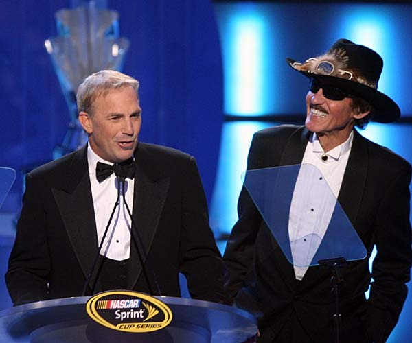 Richard Petty joins actor Kevin Costner on stage at the awards ceremony, where Costner lamented on the 60th anniversary of the sport.
