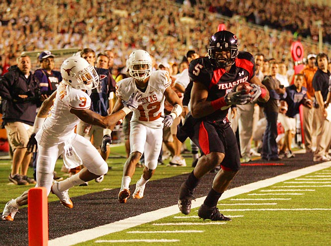 Texas Tech wide receiver Michael Crabtree, having broken free of a tackle attempt by Curtis Brown (3), scores the winning touchdown with a second left as Texas Tech knocked off No. 1 Texas.