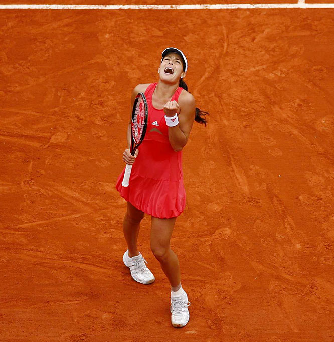 Ana Ivanovic of Serbia celebrates her victory over Dinara Safina of Russia in the women's final.