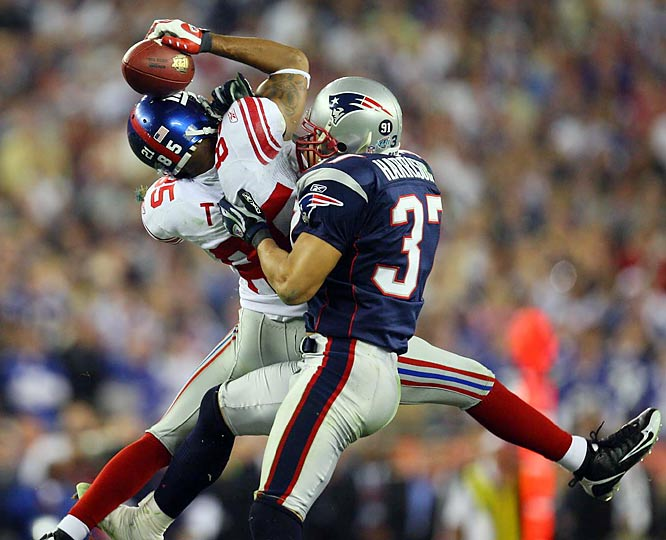 David Tyree hangs on to a clutch reception against Rodney Harrison in the Giants upset win in the Super Bowl.