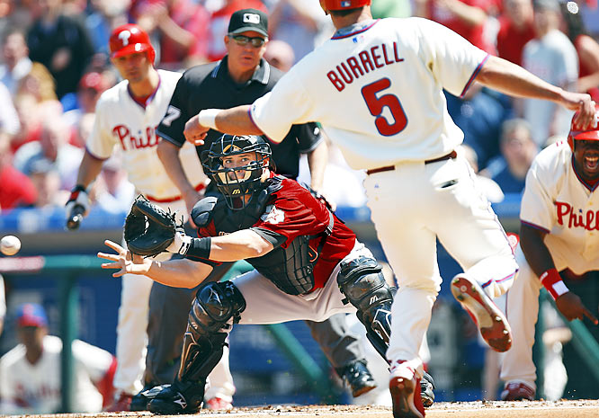 Houston catcher Humberto Quintero has his eyes on Phillies' left fielder Pat Burrell and not on the ball during the first inning of their early season game.
