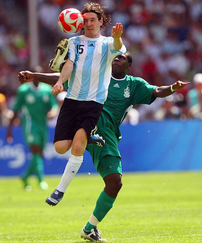 Lionel Messi of Argentina and Chibuzor Okonkwo of Nigeria compete for the ball during the Argentines' gold-medal winning match in Beijing.