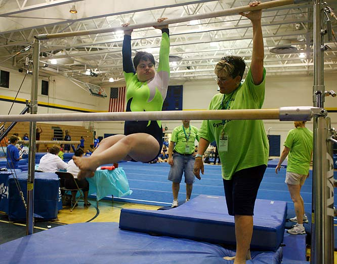 Donna Roberto, who has volunteered with Special Olympics gymnastics since 1980, coached Stacy Nonas on the uneven bars in New Jersey.
